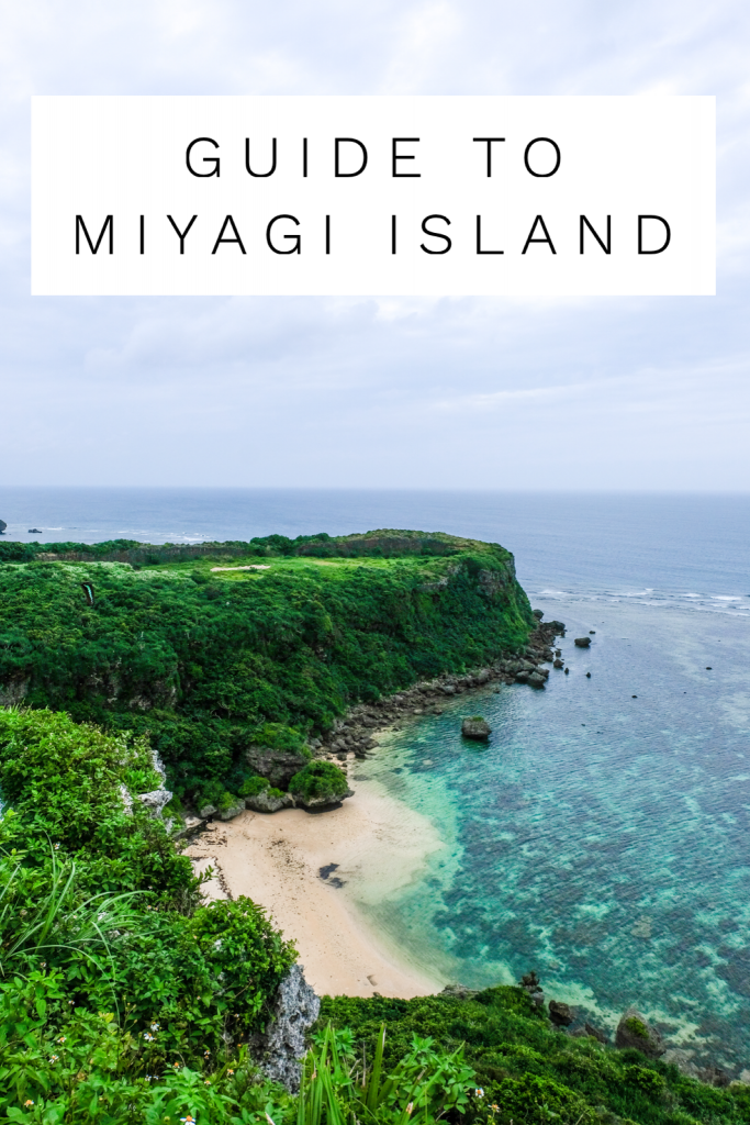 Lush green Happy Cliff overlooking turquoise water on Miyagi island